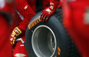 Ferrari technicians handle a Pirelli wet